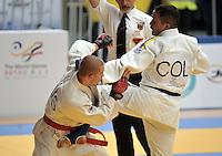 CALI – COLOMBIA – 29-07-2013: Edwin Cabezas de Colombia y Alexey Ivanov de Rusia durante combate de Ju Jitsu durante los IX Juegos Mundiales Cali, julio 29 de 2013. (Foto: VizzorImage / Luis Ramirez / Staff). Edwin Cabezas from Colombia and Alexey Ivanov from Russia during a Ju Jitsu combat  in the IX World Games Cali, July 29, 2013. (Photo: VizzorImage / Luis Ramirez / Staff).