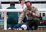 SEPT 27: Security officer Ben Denovel rushes to the aid of an injured photographer who was struck by a loose horse during the Chandelier Stakes at Santa Anita Park in Arcadia, California on September 27, 2019. Evers/Eclipse Sportswire/CSM