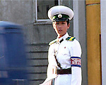 NR00066/ Policewomen deals with the traffic, in each cross roads of the town a policewomen deals with the traffic.
