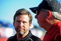 Oct. 14, 2011; Chandler, AZ, USA; NHRA top fuel dragster driver Del Worsham (left) talks with team owner Alan Johnson during qualifying at the Arizona Nationals at Firebird International Raceway. Mandatory Credit: Mark J. Rebilas-
