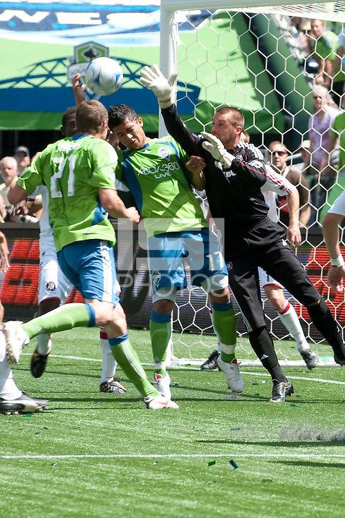 Nate Jaqua (21) and Fredy Montero (17) of the Seattle Sounders fight for the ball in the box with Jon Busch (R) of the Chicago Fire in the match at the XBox Pitch at Quest Field on July 25, 2009. The Sounders and Fire played to a 0-0 draw.