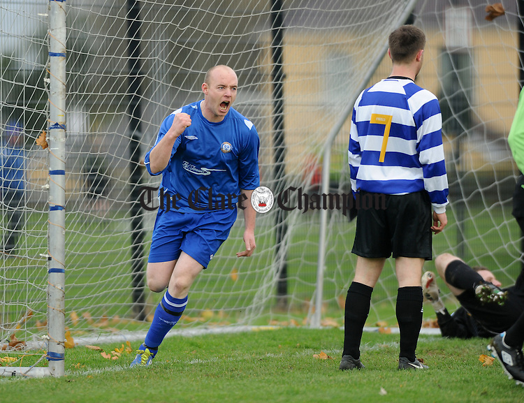Jason Whyte of Ennis Town celebrates Stephen Hickey's goal against Hermitage in action during their Premier League game at The Fair Green. Photograph by John Kelly.