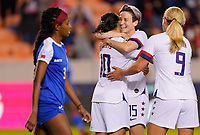 HOUSTON, TX - JANUARY 28: Megan Rapinoe #15, Carlie Lloyd #10, Lindsey Horan #9 and Lynn Williams #13 celebrate together during a game between Haiti and USWNT at BBVA Stadium on January 28, 2020 in Houston, Texas.