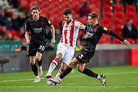 1st October 2021;  Bet365 Stadium, Stoke, Staffordshire, England; EFL Championship football, Stoke City versus West Bromwich Albion; Tommy Smith of Stoke City is tackled by Conor Townsend of West Bromwich Albion