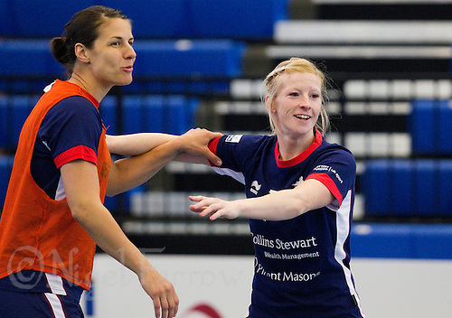 06 APR 2012 - LONDON, GBR - Yvonne Leuthold (left) and Lynn McCafferty (right) joke during a Great Britain women's handball team training session  (PHOTO (C) 2012 NIGEL FARROW)
