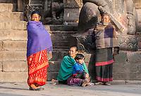 Bhaktapur, Nepal.  Women Waiting by a Temple Guardian.