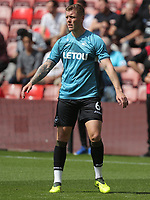 Alfie Mawson of Swansea City warms up prior to the Premier League match between Southampton and Swansea City at the St Mary's Stadium, Southampton, England, UK. Saturday 12 August 2017