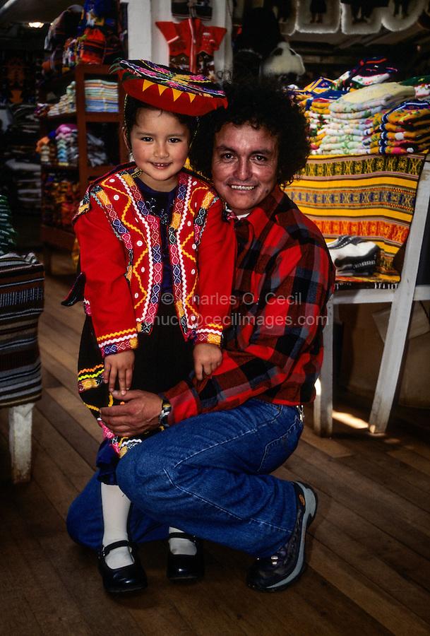 Peru, Cusco.  Little Quechua Girl and her Father.