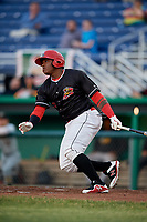 Batavia Muckdogs designated hitter Albert Guaimaro (13) follows through on a swing during a game against the West Virginia Black Bears on June 18, 2018 at Dwyer Stadium in Batavia, New York.  Batavia defeated West Virginia 9-6.  (Mike Janes/Four Seam Images)
