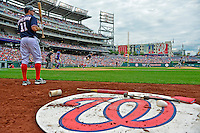 3 September 2012: Washington Nationals third baseman Ryan Zimmerman stands on deck with Bryce Harper at bat against the Chicago Cubs at Nationals Park in Washington, DC. The Nationals edged out the visiting Cubs 2-1, in the first game of heir 4-game series. Mandatory Credit: Ed Wolfstein Photo