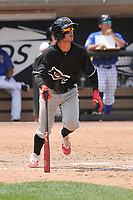 Quad Cities River Bandits shortstop Jonathan Arauz (22) watches the flight of the ball during a game against the Wisconsin Timber Rattlers at Fox Cities Stadium on June 27, 2017 in Appleton, Wisconsin.  Wisconsin lost 6-5.  (Dennis Hubbard/Four Seam Images)