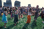1970's style hippies attend the second free festival at Stonehenge to celebrate the summer solstice June 21st 1979.