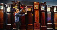 BNPS.co.uk (01202 558833)<br /> Pic: ZacharyCulpin/BNPS<br /> <br /> This may take some time....<br /> <br /> Laura Whatmoor at the Dorset Collection of Clocks faces a busy time of it. With the clocks going back an hour this Sunday, staff at the visitor attraction in Owermoigne will have to adjust over hundred clocks. <br /> <br /> The collection dates back to 1700 and includes a varied range of Grandfather clocks and Turret Church clocks.