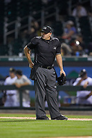 Home plate umpire Jeremy Riggs between innings of the International League game between the Toledo Mud Hens and the Charlotte Knights at BB&T BallPark on April 24, 2019 in Charlotte, North Carolina. The Knights defeated the Mud Hens 9-6. (Brian Westerholt/Four Seam Images)