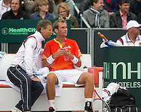 14-09-12, Netherlands, Amsterdam, Tennis, Daviscup Netherlands-Swiss,  Dutch bench with Thiemo de Bakker and captain Jan Siemerink.  on tje background Marco Bosato