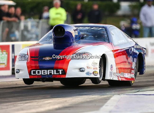 Extreme Pro Stock driver Dean Goforth (151) in his 2010 Pontiac GXP makes a qualifying pass during the ADRL World Finals drag races which were held at the Royal Purple Raceway in Baytown,Texas.