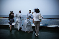 friars and pilgrims on a ferry boat on their way to Medjugorje from Ancona, Italy.