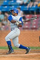 Wilmington designated hitter Wilver Perez (12) follows through on his swing versus Winston-Salem at Ernie Shore Field in Winston-Salem, NC, Saturday, June 9, 2007.
