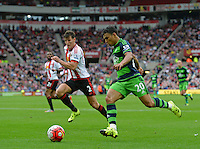 Jefferson Montero of Swansea City goes past Billy Jones of Sunderland during the Barclays Premier League match between Sunderland and Swansea City played at Stadium of Light, Sunderland