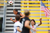 14 MAY 2011: USA Women's National Team forward Abby Wambach (20) goes up for a header the scores in the first half during the International Friendly soccer match between Japan WNT vs USA WNT at Crew Stadium in Columbus, Ohio.