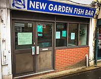 A Fish and Chip shop displays a sign showing it closes its doors to customers but will still deliver in the town centre on March 19, 2020 in High Wycombe, United Kingdom during the COVID-19 pandemic causing people to panic buy items. Photo by Andy Rowland.