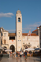 The main street Stradun Placa with traditional houses and flocks of tourists, view over clock tower and loggia loge Luza on the central square Dubrovnik, old city. Dalmatian Coast, Croatia, Europe.