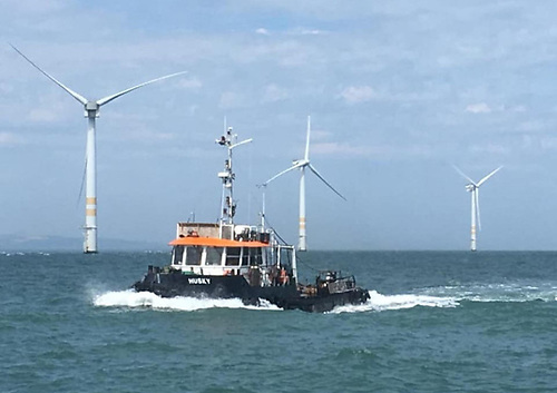 File image of Arklow Bank Wind Farm with tug Husky