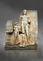 Roman Sebasteion relief  sculpture of Emperor Nero with captive, Aphrodisias Museum, Aphrodisias, Turkey.  Against a grey background.<br /> <br /> Naked warrior emperor Nero holds the orb of world rule in one hand and crowns the military trophy with the other. Between the trophy and the emperor stands a bound captive boy. He wears long barbarian trousers and looks up at Nero.