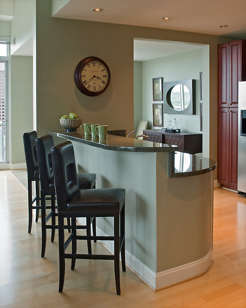 Contemporary Kitchen in Richmond Penthouse Suite, with granite counter tops and upholstered bar stools.
