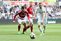 Gylfi Sigurdsson of Swansea City chases after the loose ball with Antonio Barragán of Middlesbrough during the Premier League match between Swansea City and Middlesbrough at The Liberty Stadium, Swansea, Wales, UK.