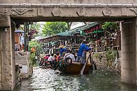 Suzhou, Jiangsu, China.  Boats Take Tourists on Canal Rides in Tongli Ancient Town near Suzhou.