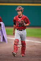 Lehigh Valley IronPigs catcher Logan Moore (11) walks to the dugout before a game against the Rochester Red Wings on May 15, 2015 at Frontier Field in Rochester, New York.  Rochester defeated Lehigh Valley 5-4.  (Mike Janes/Four Seam Images)