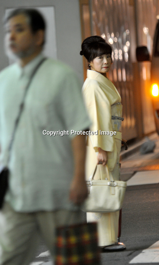 A older high-class hostess, dressed in traditional Kimono on a bar street lined with small exclusive clubs in the up-market  Ginza area of Central Tokyo, 17th September, 2008.<br /><br />PHOTO BY RICHARD JONES / SINOPIX