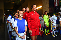 Carson, CA - Thursday August 03, 2017: Escort kids, Carli Lloyd prior to a 2017 Tournament of Nations match between the women's national teams of the United States (USA) and Japan (JPN) at the StubHub Center.