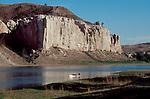 Missouri River, Canoeists paddling past the White Cliffs of the Upper Missouri River, Upper Missouri River Breaks National Monument, Montana,.