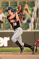 Michael Ohlman #19 of the Delmarva Shorebirds follows through on his swing against the Kannapolis Intimidators at Fieldcrest Cannon Stadium May 12, 2010, in Kannapolis, North Carolina.  Photo by Brian Westerholt / Four Seam Images