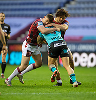 29th April 2021; DW Stadium, Wigan, Lancashire, England; BetFred Super League Rugby, Wigan Warriors versus Hull FC;  Josh Griffin of Hull KR is tackled by  Ethan Havard and  Liam Byrne of Wigan Warriors