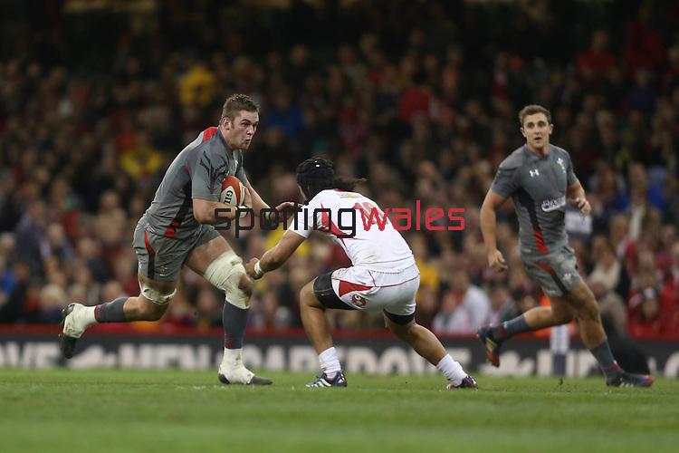 Wales flanker Dan Lydiate takes on Latiume Fosita.<br /> <br /> Dove Men Series 2013<br /> Wales v Tonga<br /> Millennium Stadium - Cardiff<br /> 22.11.13<br /> ©Steve Pope-SPORTINGWALES