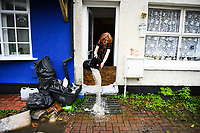 Flooding effected the villages of Aberdulais and Tonna in the Neath Valley after Storm Callum brought heavy rain and wind to the area cuasing the River Neath to reach bursting point.<br /> A women pours water from her home at Canal Side, Tonna, Neath. Saturday 13 October 2018