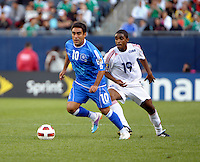 El Salvador's Eliseo Quintanilla dribbles away from Cuba's Francisco Carrazana.  El Salvador defeated Cuba 6-1 at the 2011 CONCACAF Gold Cup at Soldier Field in Chicago, IL on June 12, 2011.