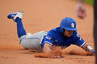 Indiana State Sycamores Josue Urdaneta (2) slides head first into third base during the teams opening game of the season against the Pitt Panthers on February 19, 2021 at North Charlotte Regional Park in Port Charlotte, Florida.  (Mike Janes/Four Seam Images)