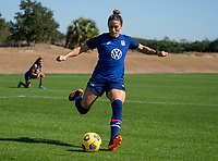 ORLANDO, FL - JANUARY 20: Ali Krieger #11 of the USWNT crosses the ball during a training session at the practice fields on January 20, 2021 in Orlando, Florida.