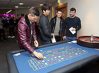 Pictured L-R: Players Federico Fernandez, Ki SUng Yueng, Matt Grimes and Jordi Amat gambling at the roulette table <br /> Re: Swansea City FC Christmas party at the Liberty Stadium, south Wales, UK.