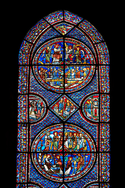 Medieval stained glass Window of the Gothic Cathedral of Chartres, France - dedicated to the Life of St Mary Magdalen. A UNESCO World Heritage Site.