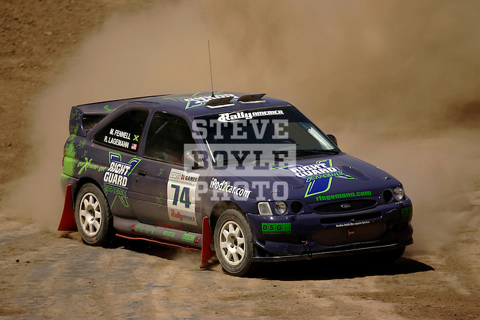Driver Ramana Lagemann and co-driver Mike Fennell come around a turn near the finish line while competing in the Rally Car Race finals during X-Games 12 in Los Angeles, California on August 5, 2006.