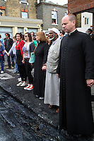 Two priests and an imam join with the local community to pray as they begin to clean up the damage in the London borough of Hackney. London saw the beginnings of riots on Saturday evening, after a peaceful protest in response to the shooting by police of Mark Duggan during an attempted arrest, escalated into violence. By the third night of violence, rioting and looting had spread to many areas of the capital and to other cities around the country.
