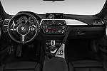 Stock photo of straight dashboard view of 2015 BMW 3 Series 328d xDrive Sports Wagon 5 Door Wagon Dashboard