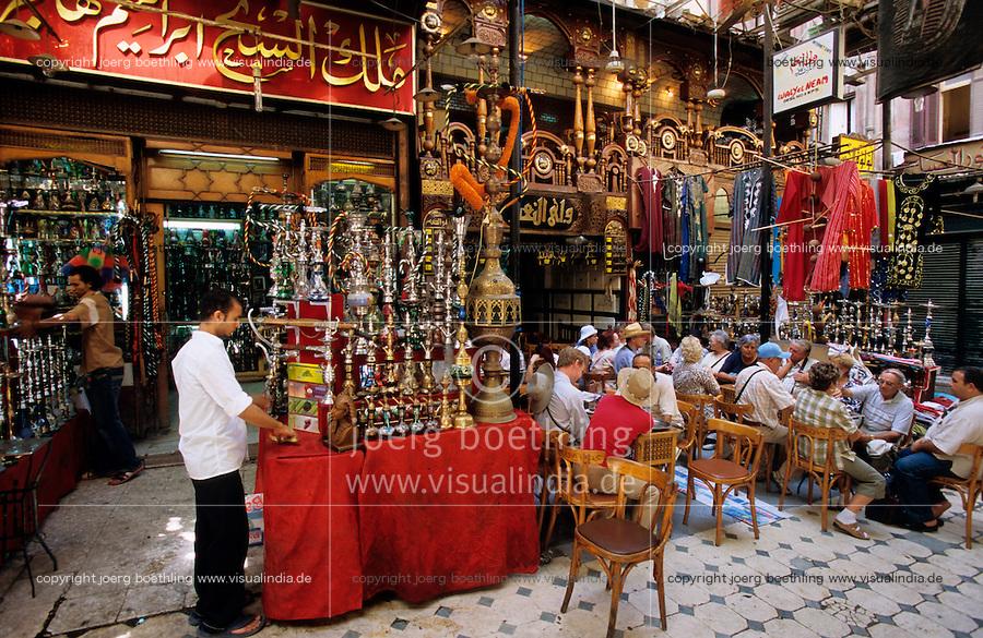 EGYPT Cairo, western tourist in Restaurant in Khan el Khalili , people celebrate Iftar the fast break in holy month Ramadan / AEGYPTEN Kairo Cairo , westliche Touristen im Restaurant im Basar im Stadtteil Khan el Khalili waehrend des Iftar Fest dem Fastenbrechen im Fastenmonat Ramadan