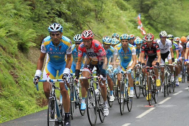 The peloton led by Astana approach the summit of the Cat 1 climb at Col du Marie Blanque during a wet foggy Stage 17 of the 2010 Tour de France running 174km from Pau to Col du Tourmalet, France. 22nd July 2010.<br /> (Photo by Eoin Clarke/NEWSFILE).<br /> All photos usage must carry mandatory copyright credit (© NEWSFILE | Eoin Clarke)
