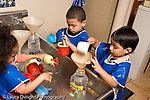 Education preschoool children ages 3-5 water table group playing separately horizontal